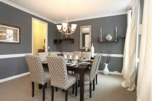 dining room interior with grey walls and hardwood