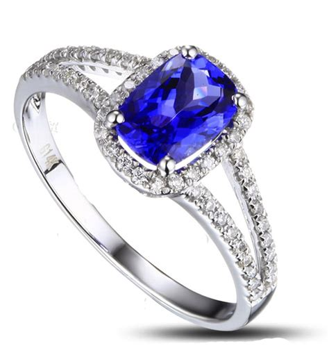 2 carat cushion cut sapphire and halo engagement
