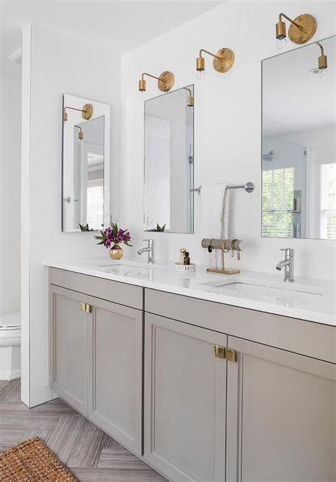 stunning bathroom boasts a gray dual vanity adorned with
