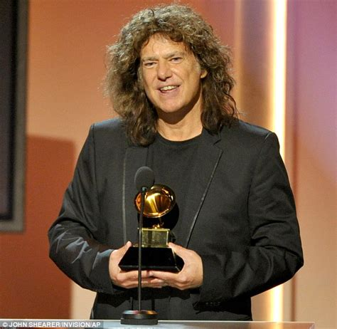 grammy awards 2013 shares an emotional embrace with song writing partner