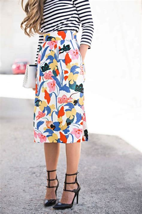 Picture Of bold floral skirt, a striped long sleeve and black heels