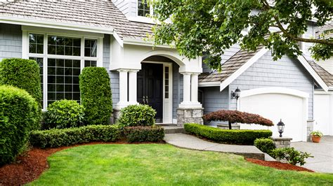Nice Front Yard Landscaping With Concrete Walkway And