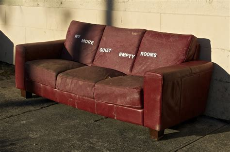 empty couch clever typographic street art from quot miguel marquez outside