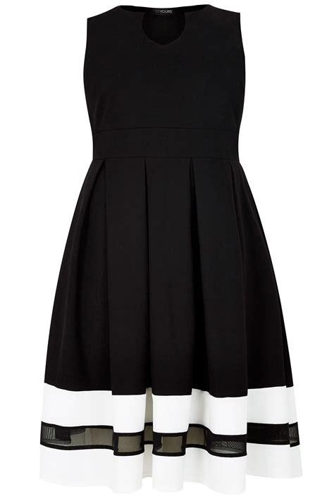 black textured skater dress with contrasting mesh hem