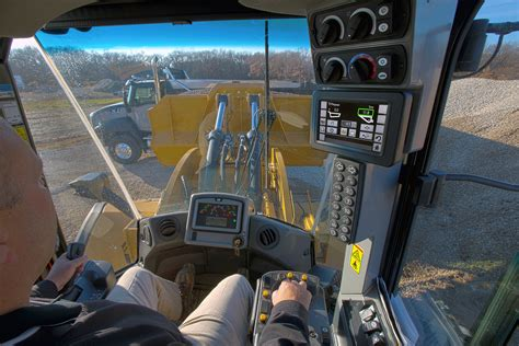cat  series wheel loaders deliver production efficiency  integrated cat production