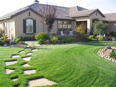 green landscape ideas for ranch style homes by the