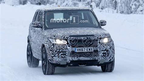 new land rover defender spy land rover designer says new defender will put g class in