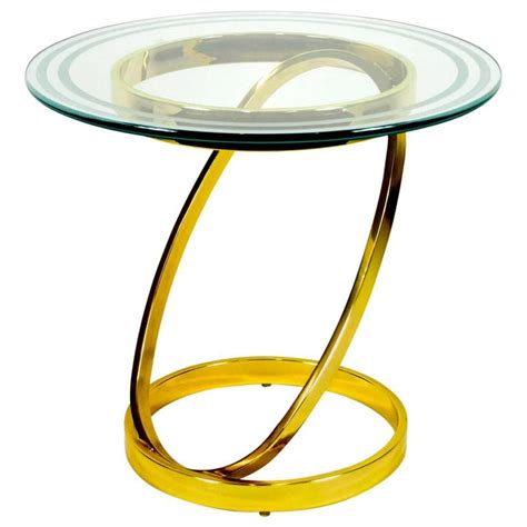 small decorative brass finish table with glass top at 1stdibs