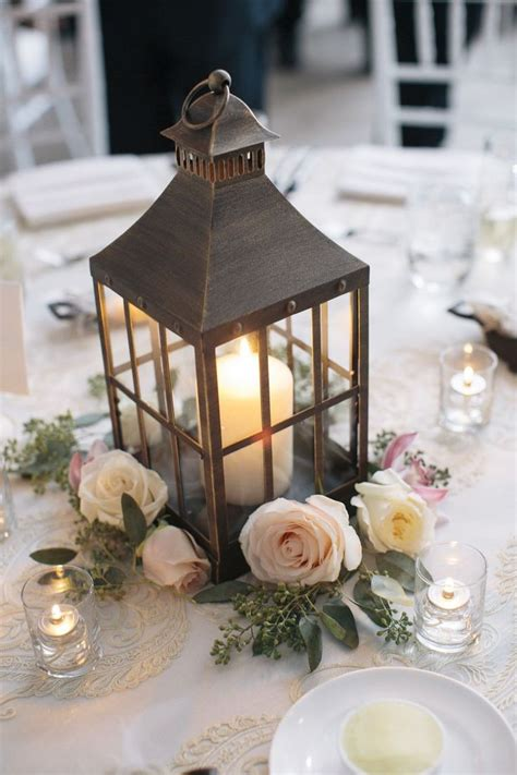 lantern floral centerpieces the 25 best ideas about lantern wedding centerpieces on