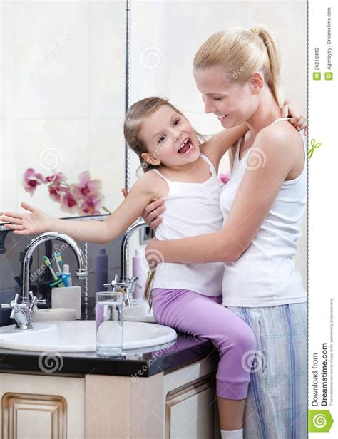 daughter in bathroom mum and daughter are in the bathroom royalty free stock