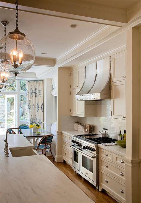 cream kitchen cabinets  french kitchen hood