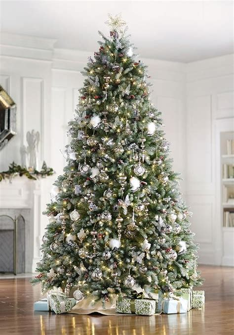 snowiest fake tree the dunhill fir faux tree includes clear lights snow berries and cones