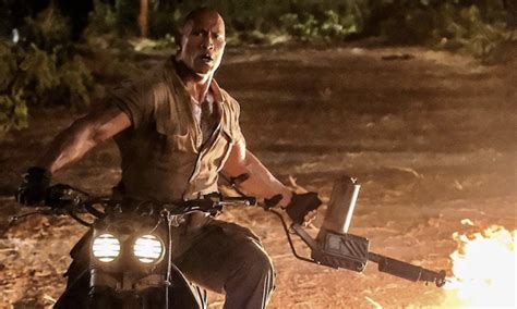 jumanji movie new new jumanji movie has the rock on a motorcycle with a
