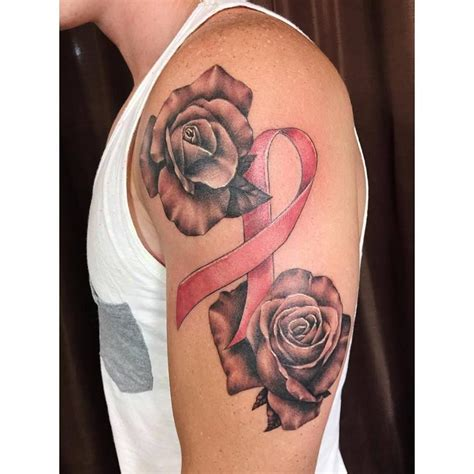 rose tattoo with ribbon chronic ink toronto roses and a breast