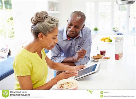 Couples Free Web American Using Digital Tablet At