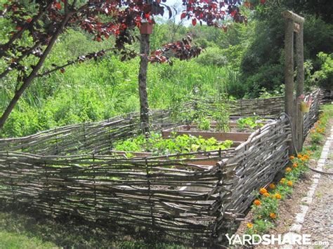 landscaping ideas raised beds enclosed  wattle fence