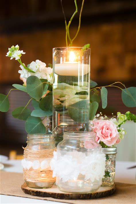 wedding centerpieces with jars and candles unique centerpiece a cluster of floating candles and burlapcovered jars added to the