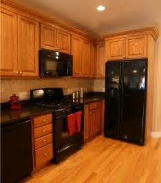 Black Oak Kitchen Cabinets 25 Best Black Appliances Ideas On Kitchen Black Appliances Large Granite Kitchen
