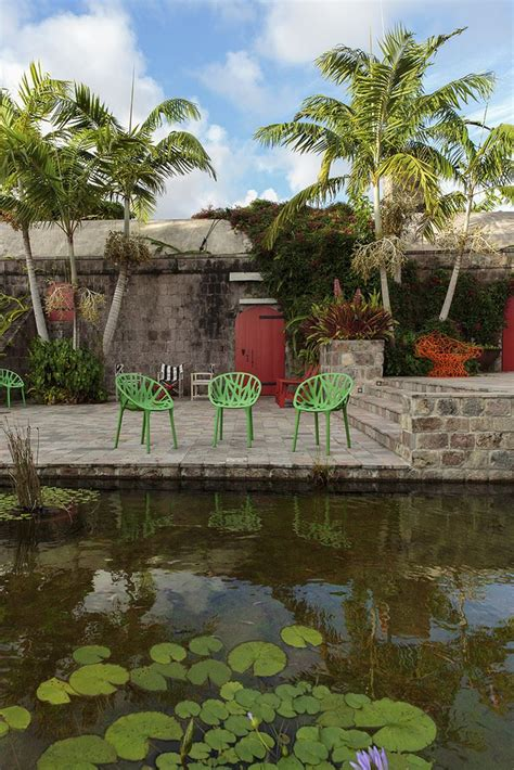 good Garden Patio Ideas Pictures #3: Tropical-patio-with-Vitra-chairs.jpg