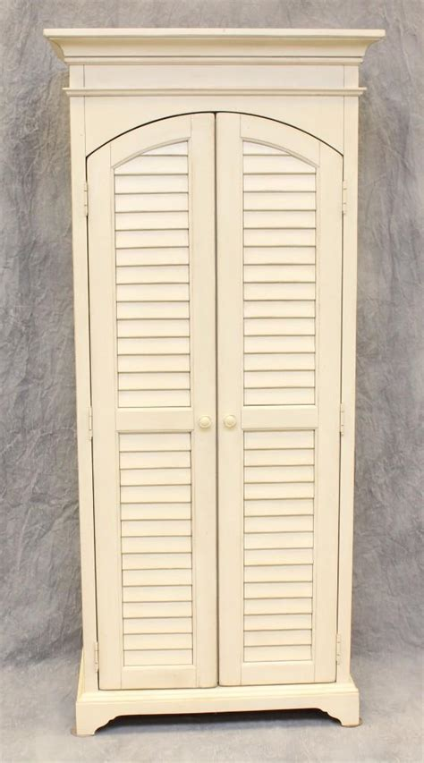 louvered armoire louvered armoire 28 images bramore louvered cabinet from steinworld 12320 coleman