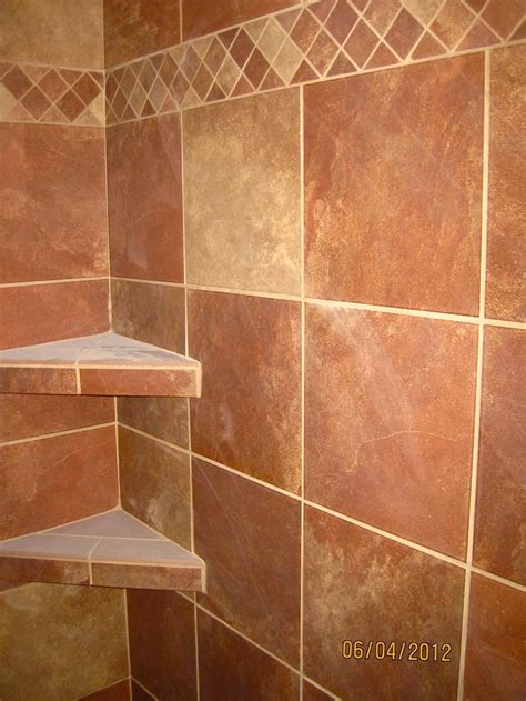 decorative bathroom tile borders 12x12 stonepeak lava tile set with 2x2 mosaic as