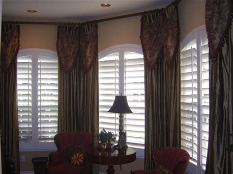 3 blind mice window coverings arched plantation wood shutters with drapery side panels