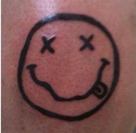 nirvana smiley face tattoo nirvana smiley tattoos and piercings