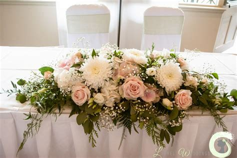 table flower blush pink and ivory ceremony table arrangement at the