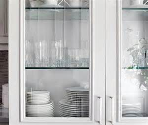 Displaying fine china behind glass front cabinets presents a feeling