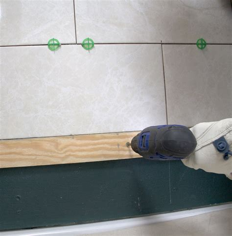 how to put tile on wall in bathroom how to tile a shower