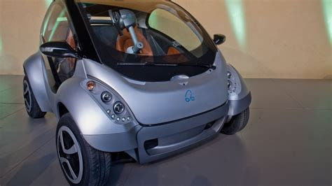 car seat in 2 seater hiriko the fold up electric two seater car for 2013