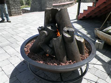 hand made gas fire cauldron with steel logs by hellgate forge custommade com