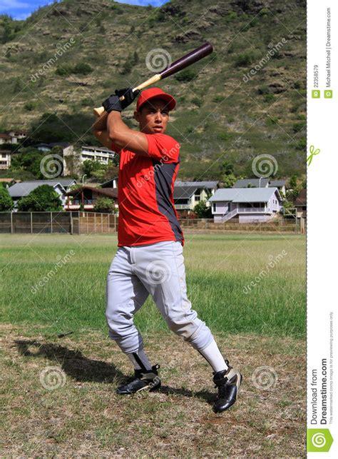 swing player baseball player focuses at bat royalty free stock images