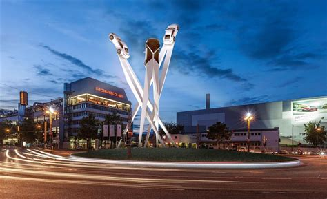 porsche stuttgart porsche puts massive 911 sculpture on roundabout in