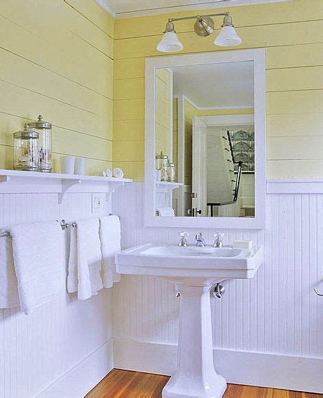 bathroom ideas with beadboard tongue and groove painted yellow above beadboard painted white below pedestal sink narrow