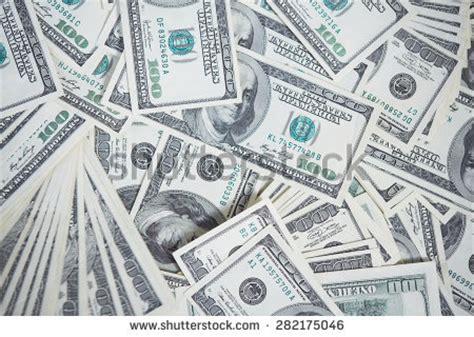 100 Bill On The Floor - stack 100 bills us currency on stock photo 12023995