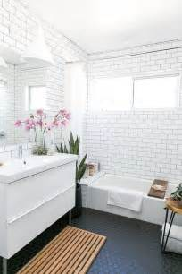 Modern Subway Tile mid century modern bathroom with white subway tiles on the walls and