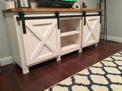 farmhouse sliding door cabinet build a tv stand or media console with these free plans