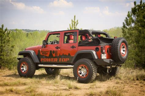 rugged ridge power top rugged ridge powertop adds convenience to jeep s wrangler unlimited