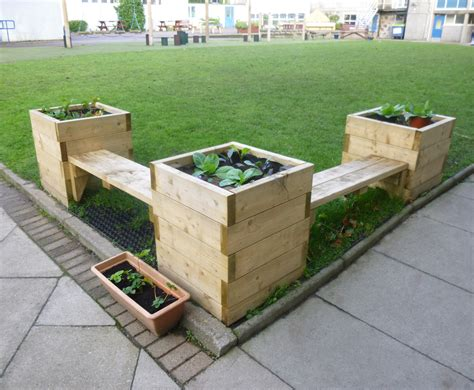 Planters With Bench Seating by Bench And Planter Combination Caledonia Play