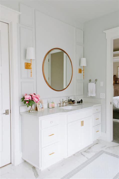 gold mirror bathroom a serene marble bathroom with a freestanding white tub