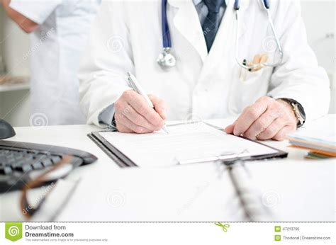 Writing Desk White Doctor Signing A Medical Report Stock Photo Image 47213795