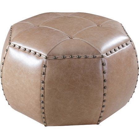 Leather Trimmed Upholstery - wrapped in gently tufted leather upholstery this nailhead