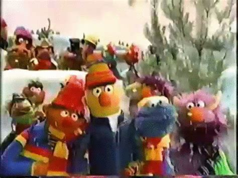 best status gif on christmas a muppet family gif find on giphy