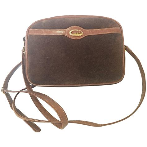 vintage gucci brown suede oval shape shoulder purse with riri zippers for sale at 1stdibs