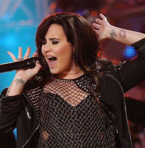 Demi Lovato's Tattoos   Artistic Design Tattoo on Forearm