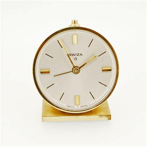 swiza 8 day alarm clock brass krafft jewellers