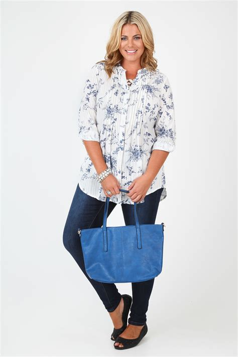 The B Club Print Blouse Blue and blue floral print woven blouse with pleat detail