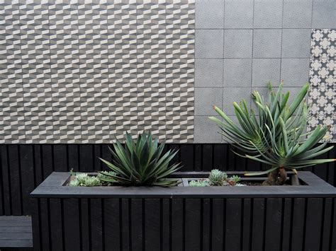 Plant Cloddig raised planter with shiplap cladding and tiled feature