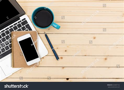 laptop on a desk working space laptop notepad on wooden desk stock photo